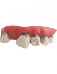 Accessorio scherzoso: finti denti cariati con diamanti