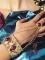 Braccialetto con anello dorato e pietre rosse donna-1