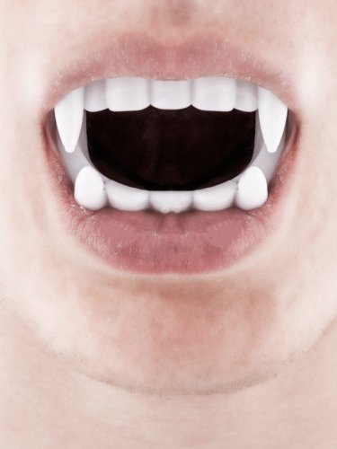 Dentiera da vampiro bianca Halloween